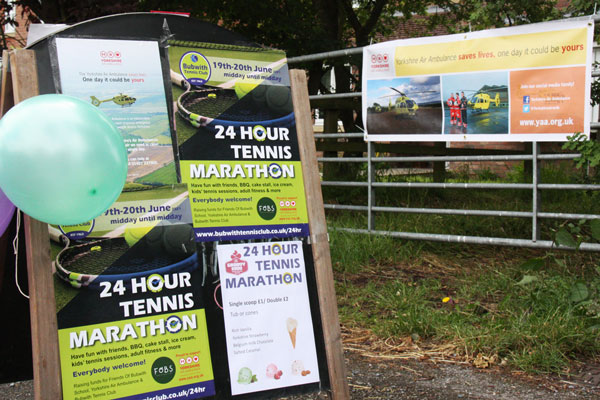 Signs for the 24 Hour Tennis Marathon 2021