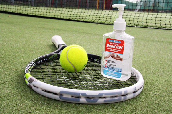 Tennis racket with a ball and hand sanitiser