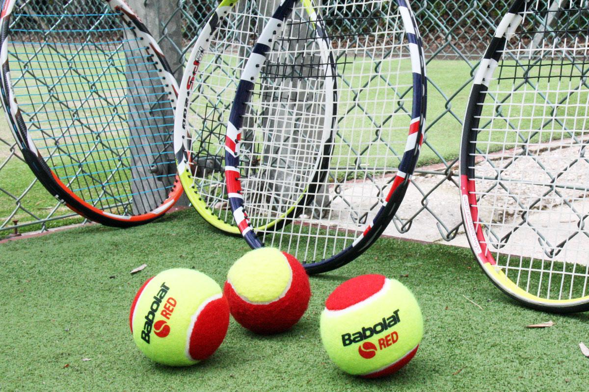 Tennis rackets with junior tennis balls